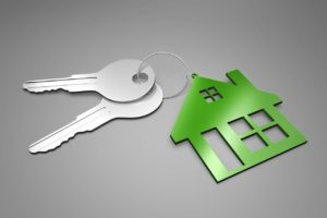 Keys on a Green House Shaped Key Ring | Keys to Successful Home Buying