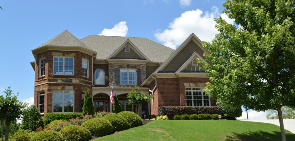 Large brick front home showing nice landscaping | curb appeal