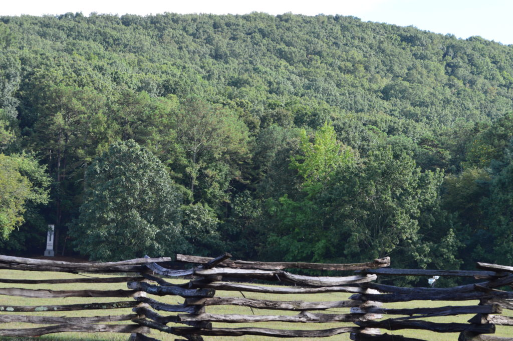 Overlooking Kennesaw Mountain with cross rail fence in the foreground