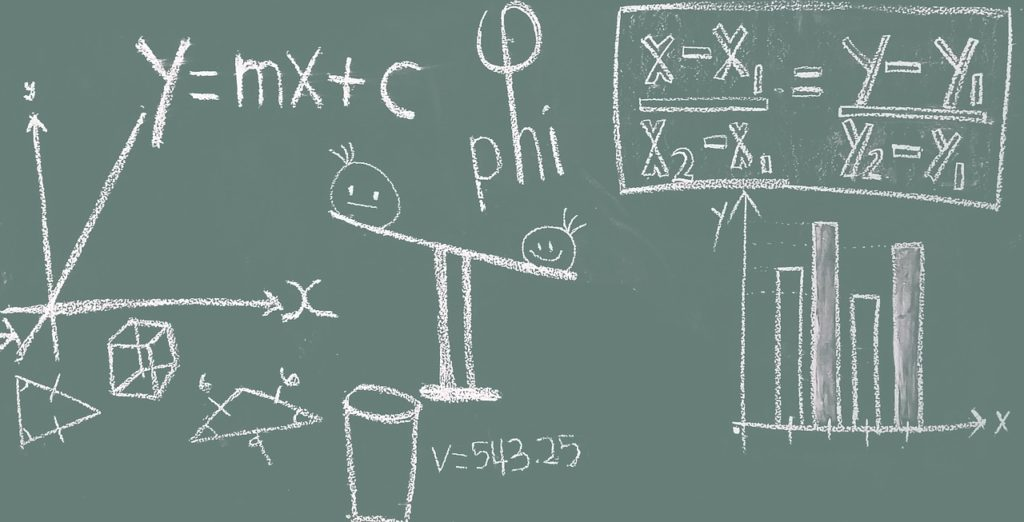 mathematical calculations part of home selling process shown on green chalkboard