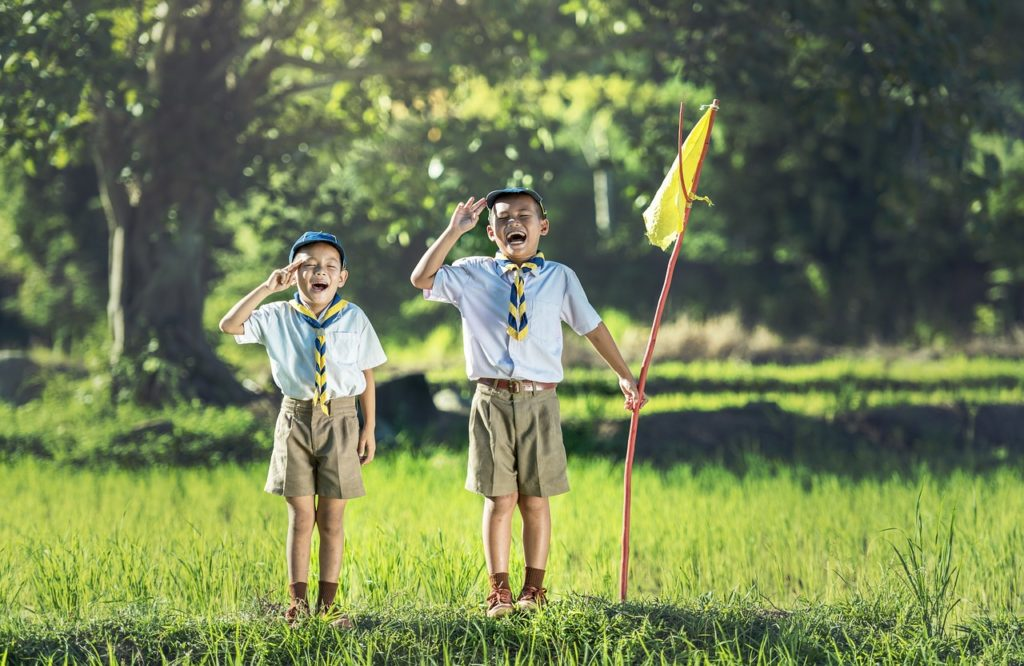 Selling a Home | Pledge | Two boys saluting yellow flag