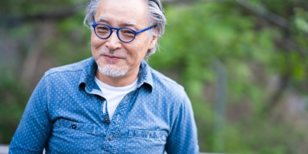 senior asian man blue glasses