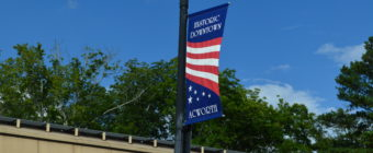 acworth centennial banner on light pole against blue sky