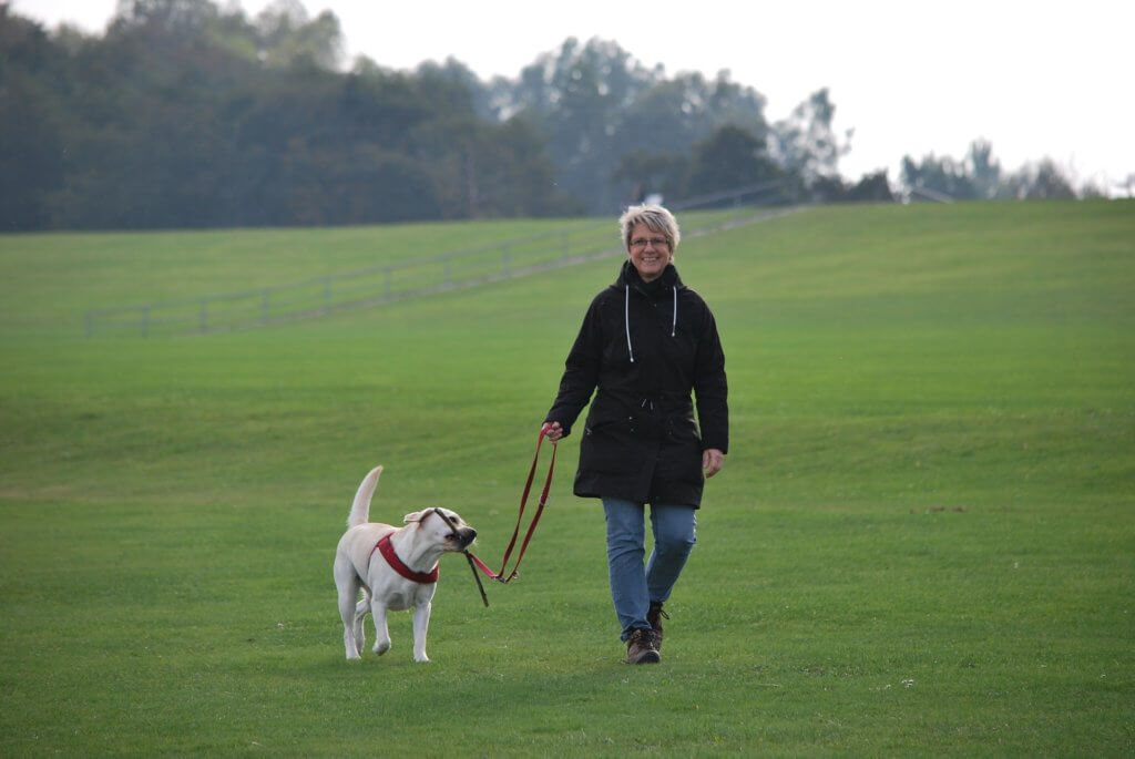 Smiling woman walking do | Arbor Ridge | Pet Friendly