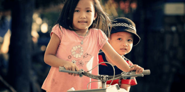 Cute Kids on Bicycle Slider