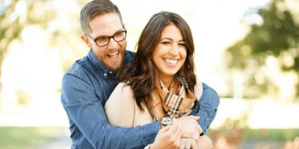 Happy couple celebrating embracing slider