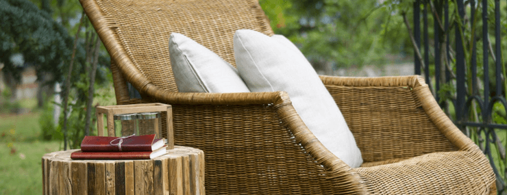 relaxing chair and reading material outdoors | Active Adult Lifestyle | DRA Homes