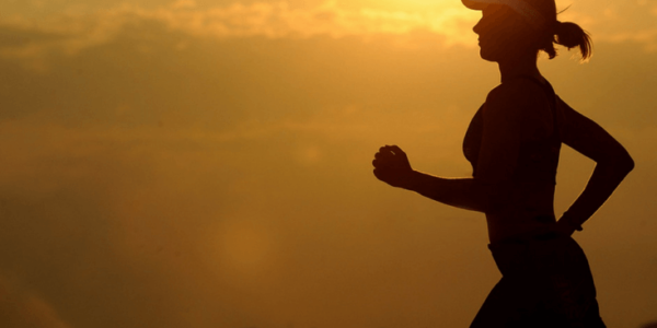woman running at sunset slider