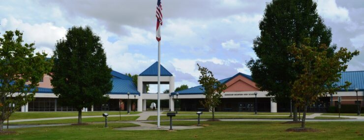 kennesaw mountain high school building with American flag in front