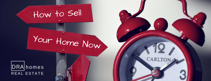 "Red sign post with ""How to Sell Your Home Now"" in white next to a vintage red alarm clock 