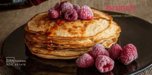 Pancakes with Syrup & Raspberries for Brunch | DRA Homes Watermark